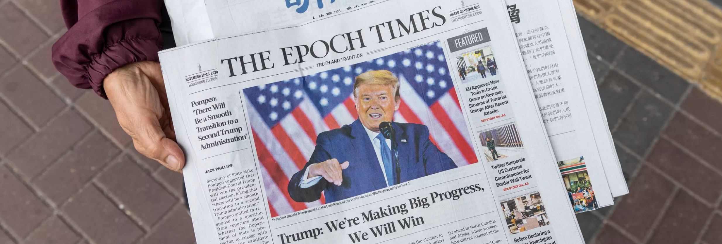 A picture of a copy of the Epoch Times