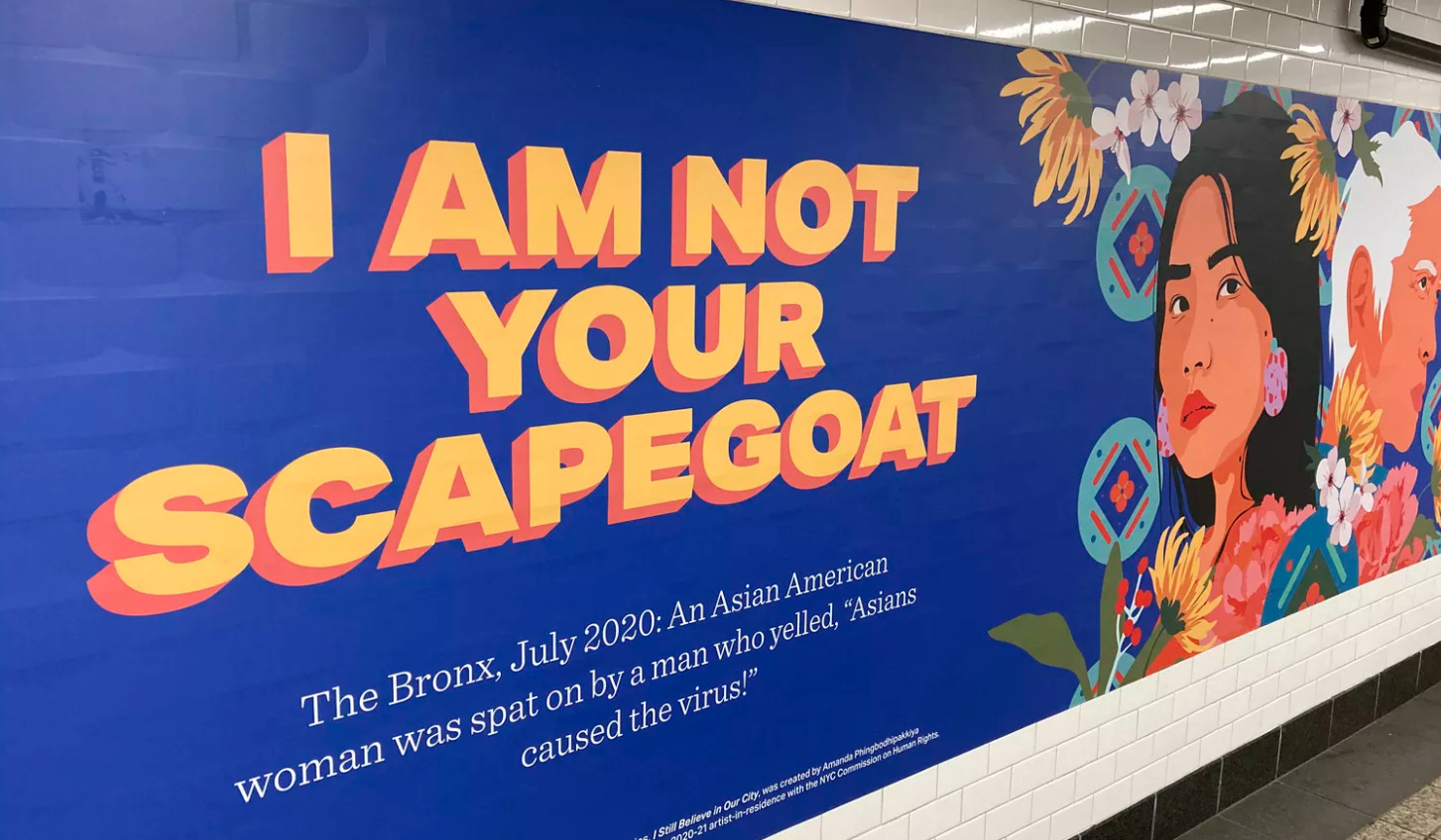 "A billboard in New York City depicts an Asian American woman. The headline reads, ""I am not your scapegoat."""