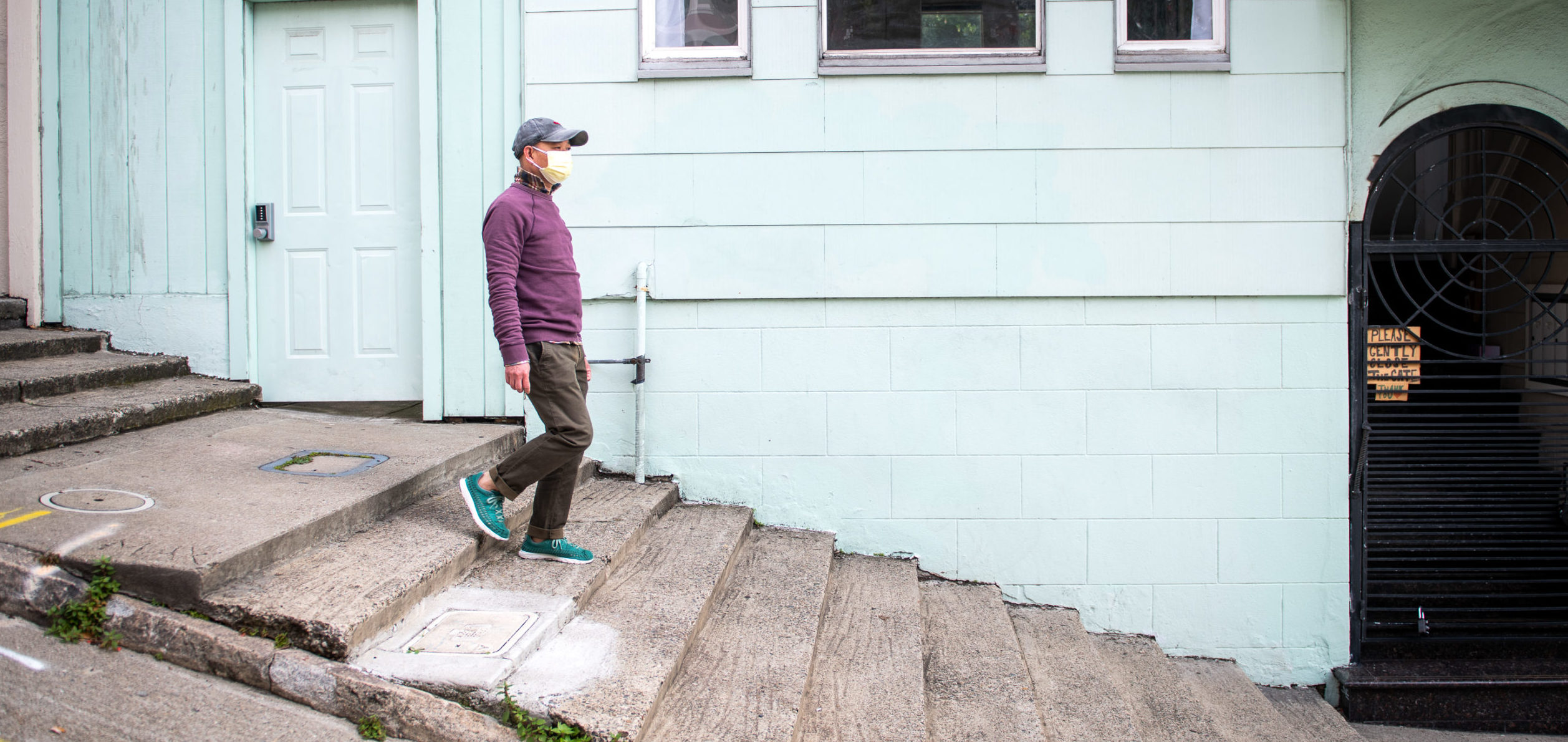 Henry Zhang, a middle-aged immigrant from Taishan, China walks down a set of stone steps in San Francisco's Chinatown neighborhood.