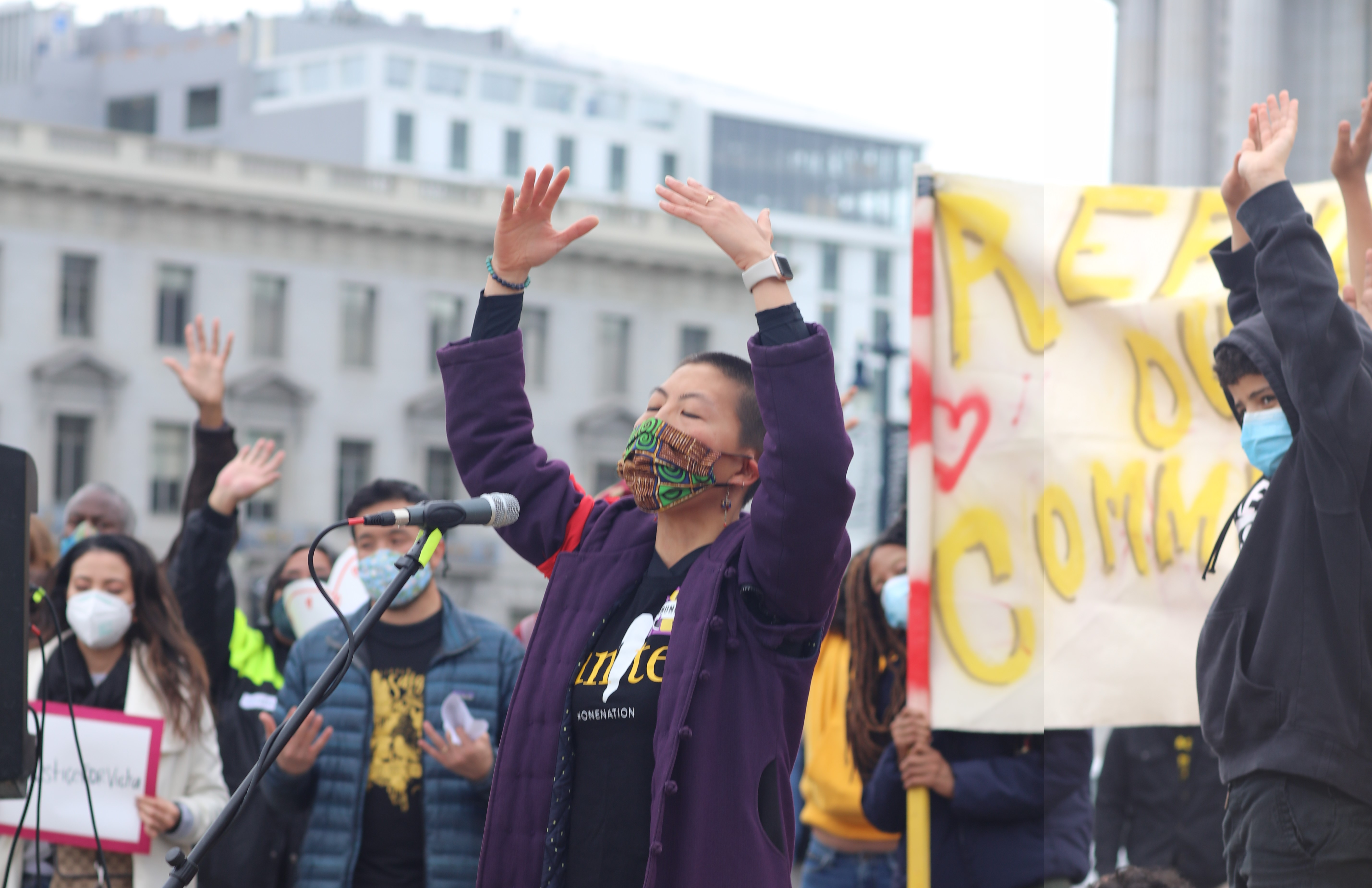 Sassana Yee of Communities of One leads rally participants in prayer at the San Francisco Day of Action in Civic Center Plaza. (Image Credit: TC Chang for CAA)