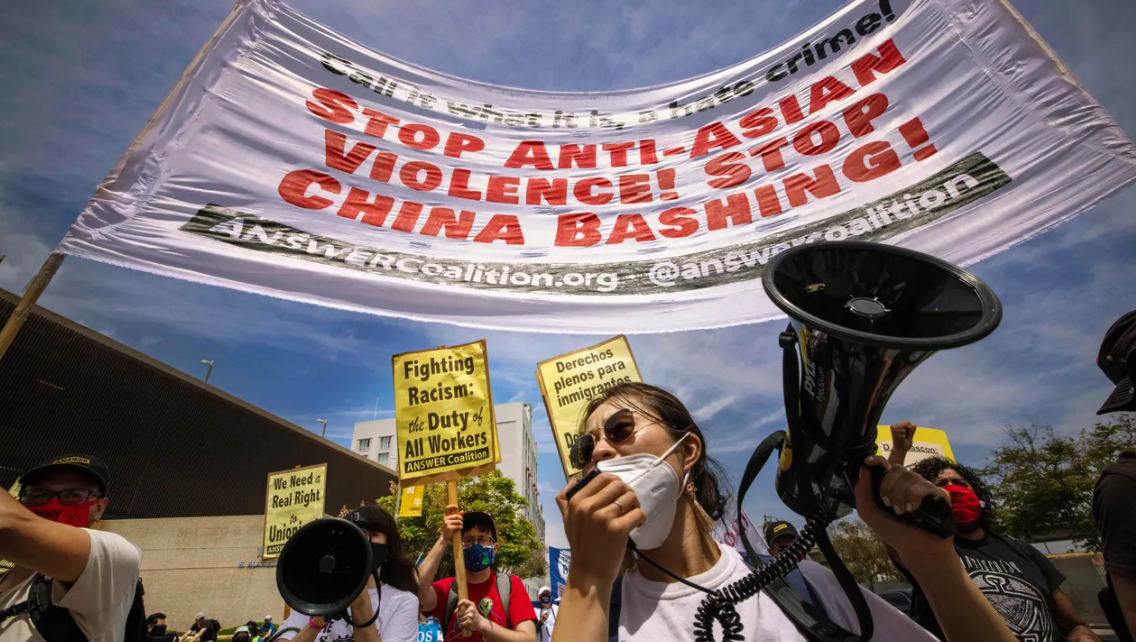 Protesters against anti-Asian violence participate in a May Day march for workers' and human rights in Los Angeles on May 1