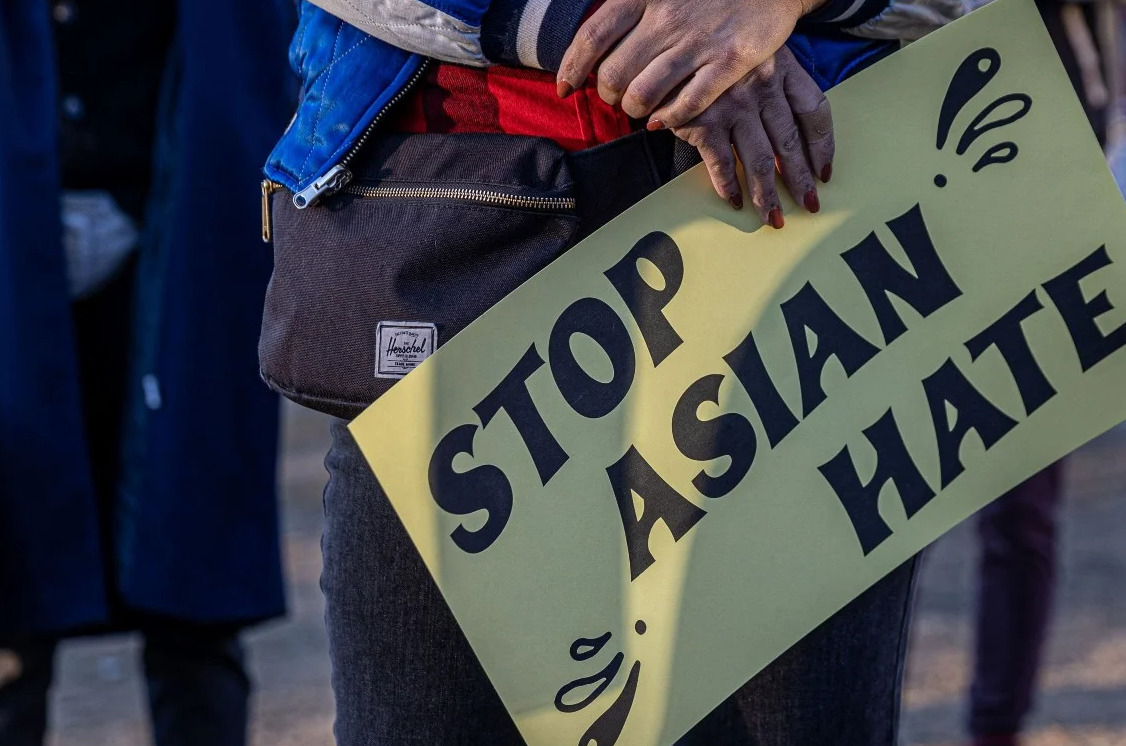 A protester holds up a Stop Asian Hate sign